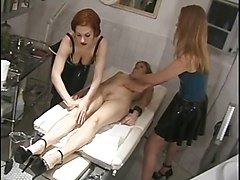 Naked broad gets massage from chicks in rubber