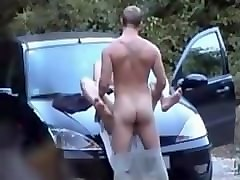 french couple gets caught fucking on the hood of their car in the woods